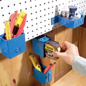 Hang electrical junction boxes    Electrical junction boxes can hold a lot more than wiring. You can nail or screw them to just about anything anywhere. In the shop, they're great for those tools that can't hang on hooks—tape measures, markers, chisels, etc. Plastic boxes come in various sizes and shapes and cost 75¢ to $3 each.