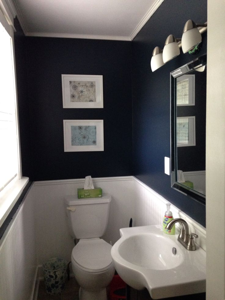 Nautical theme powder room; Benjamin Moore Polo Blue - powder room with white under chair rail