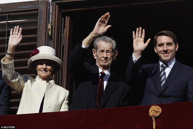 Romania's former King Michael (C), accompanied by his daughter Princess Margareta and his ...