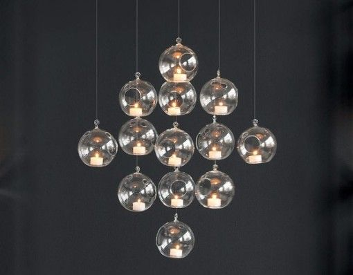 Whirly Hanging Candle Holder- Create a stylish chandelier with this sphere handblown glass candle holder that hangs above. http://shopfor20.com/product/whirly-hanging-candle-holder/