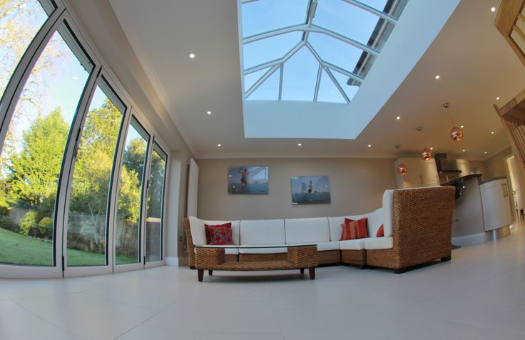 Internal view of white frame bifold doors and roof lantern.
