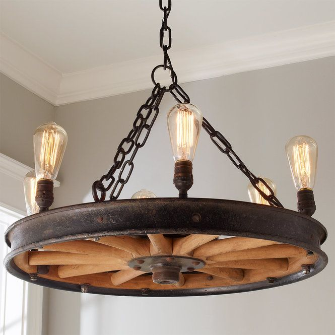 Made From An Antique Car Wheel With A Raw Metal Rim And Original Wooden Spokes This Piece Of Americana History Has Wooden Wheel Wheel Decor Diy Light Fixtures