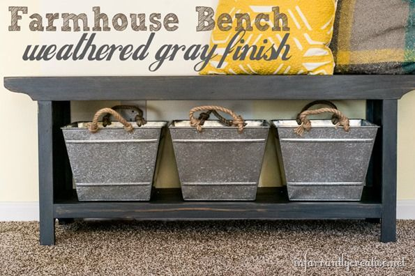 This DIY farmhouse bench with weathered gray finish is the perfect addition to your entryway. It includes hidden storage underneath, perfect for shoes, hats, gloves, and more!