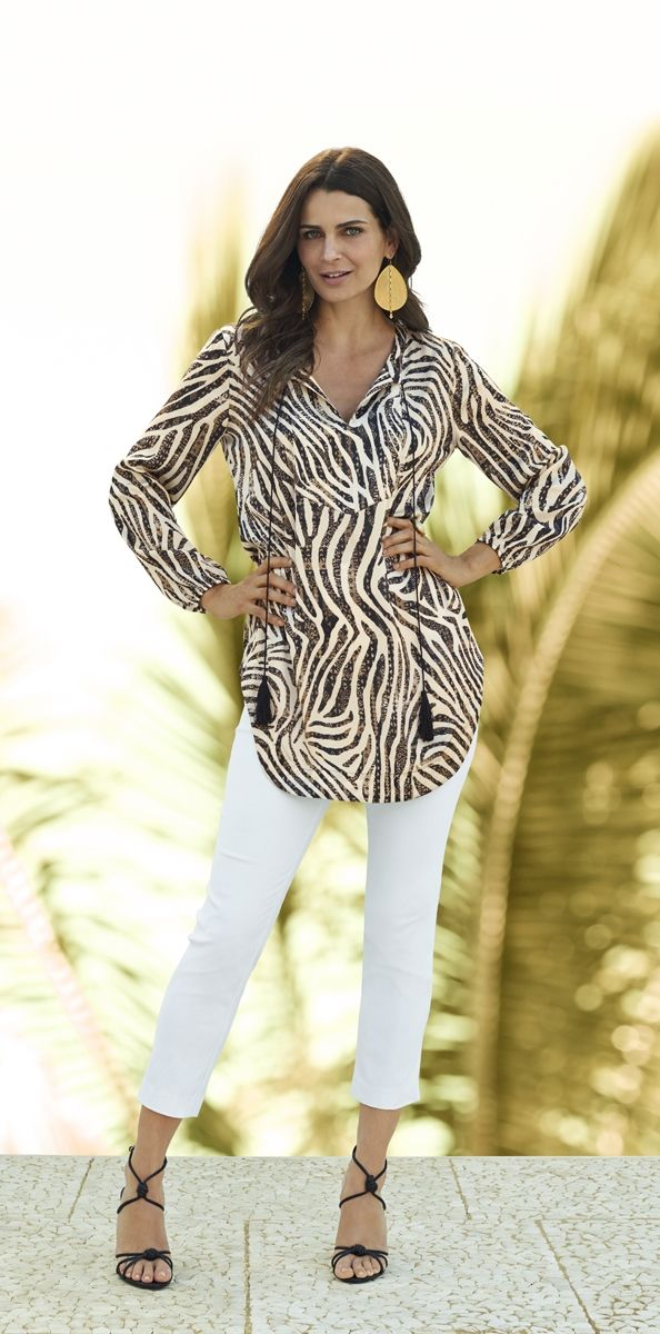 Look closely and you'll see the tribal print inside the zebra stripes—a wildly chic combination.