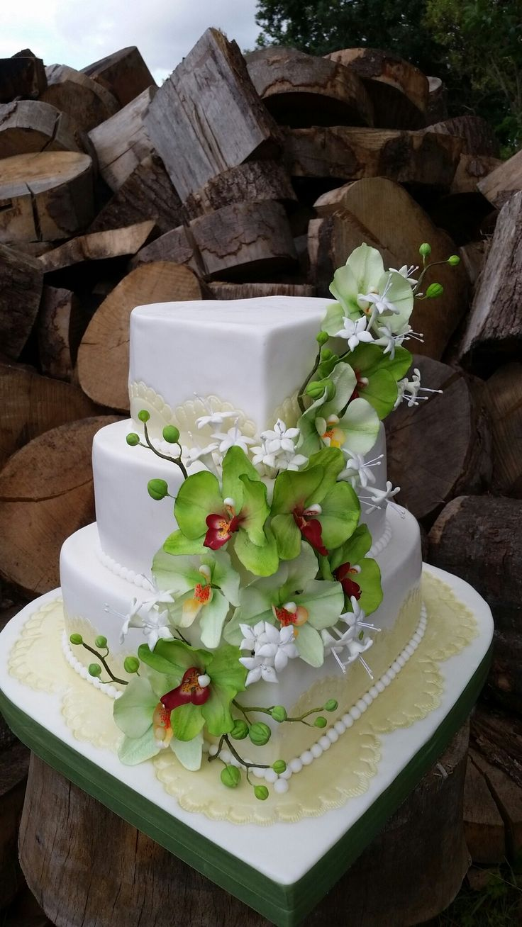 Wedding cake with green orchids.