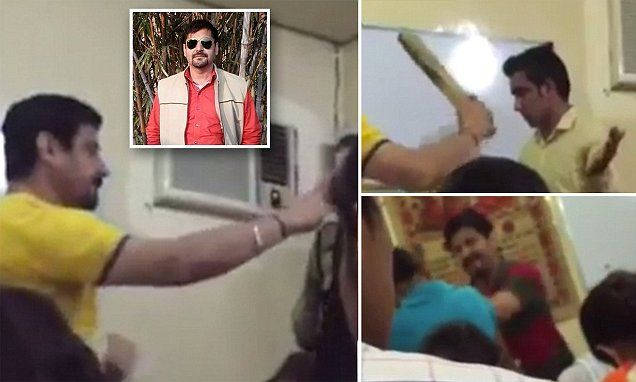 Violent teacher caught on camera slapping students and giving them the CANE with a block of wood as they wince in pain   Daily Mail Online