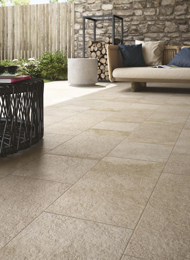 This covered outdoor seating area looks great with the Stoneway Porfido collection tiles. Perfect for outside in areas.  #internal #external #tiles