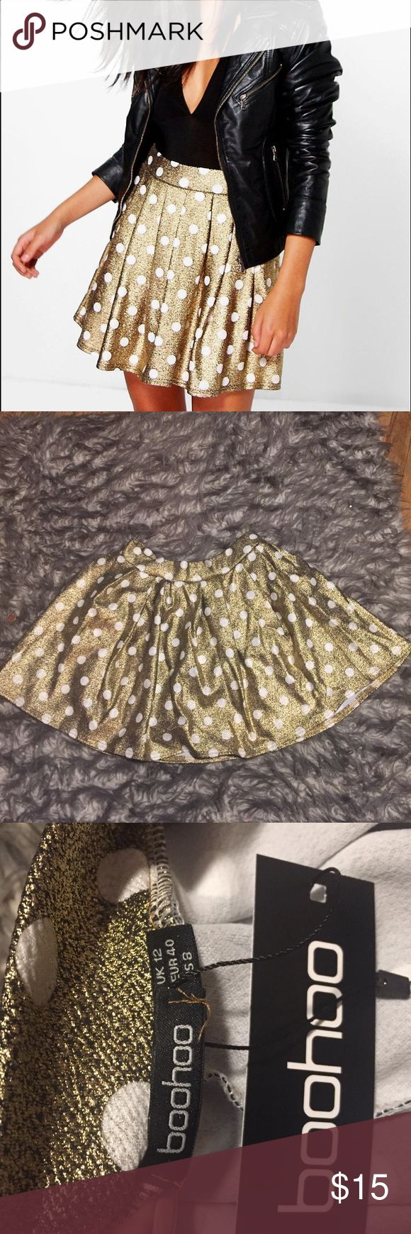 "Metallic polka dot skater skirt NWT- from Boohoo site: Fabric: 95% Polyester, 5% Elastane. Flat Measurement: Total Length 41cm/16"". Waist 33cm/13"". Hem Width 52cm/20.5"". Elasticated Waist. Machine Washable. Measured on a UK Size 10. Model Wears UK Size 10. Boohoo Skirts Circle & Skater"