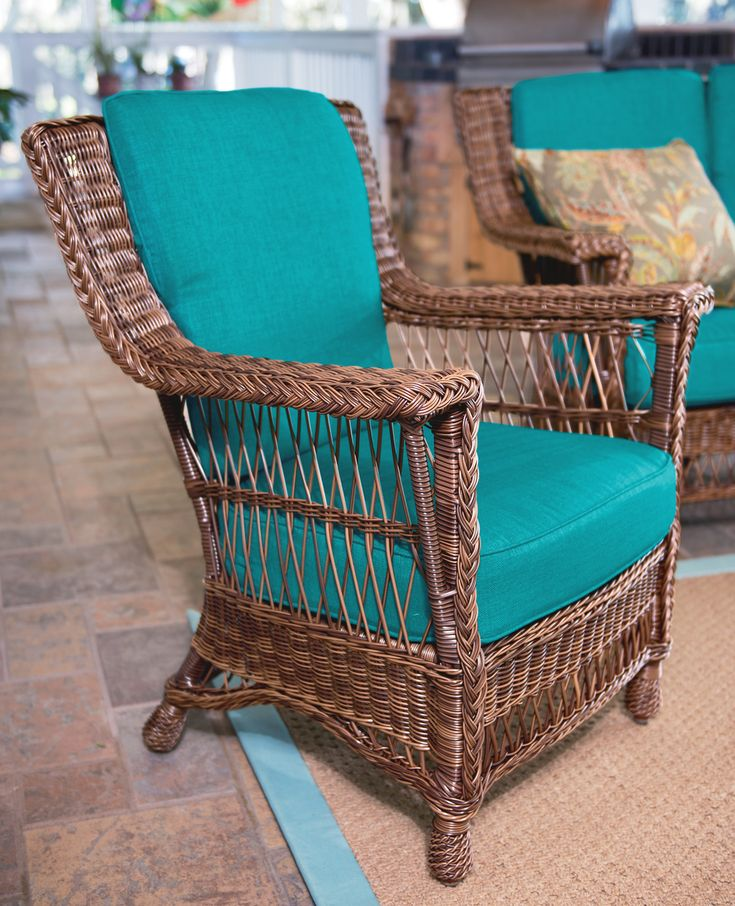 NEW | Resin Wicker Armchair Brings Living Room Comfort to the Great Outdoors  Graciously-sized and weatherproof outdoor furniture brings comfort and style to your outdoor spaces.  Classic armchair has intricately hand-woven resin wicker back and sides. Designed and manufactured to last for decades. Choose Peacock Blue or Sand cushion color.