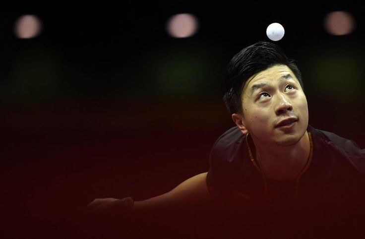 Ma Long serves during the men's final match against Fang Bo at the 2015 World Table Tennis Championships in Suzhou, China