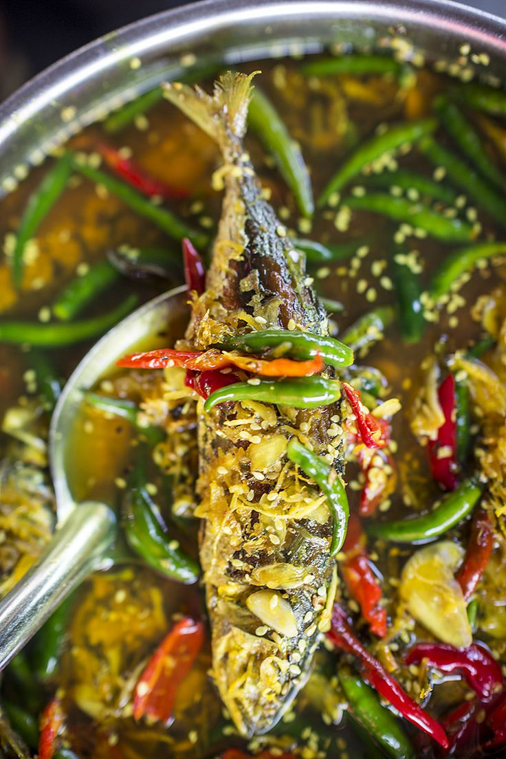 Achar hu: fried fish marinated in turmeric-vinegar oil with garlic, ginger and chilies