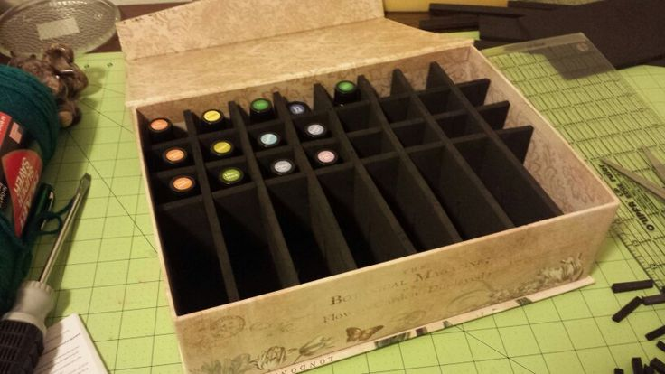 """DIY essential oil storage box So easy! Just find a box you like. I bought a pretty one at Michael ' s and used a coupon on it so it was super cheap. Buy sheets of the thick kids craft foam. Cut strips to fit both directions. I made mine 2.5 """" tall but could go a little shorter depending on height of oil bottles. Figure out how many bottles you can fit going each direction. Divide the length of the strips by how many bottles. So I could fit 8 bottles across and my strip was 12"""". 12 divided by…"""