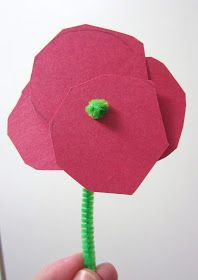 Craft for Remembrance or Memorial Day: Simple poppy with pipe cleaner and red construction paper.