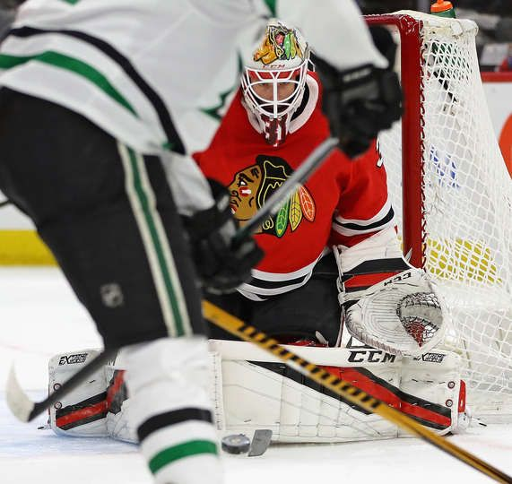 CHICAGO, IL - FEBRUARY 08: Anton Forsberg #31 of the Chicago Blackhawks stops a shot by Radek Faksa #12 of the Dallas Stars at the United Center on February 8 2018 in Chicago, Illinois. (Photo by Jonathan Daniel/Getty Images)