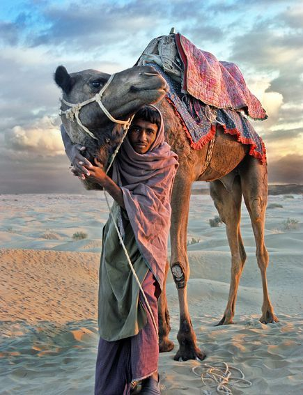 Photograph by Glenn Losack, My Shot  Sam dunes in the Indian desert near the border with Pakistan. Camel wallah and his friend.