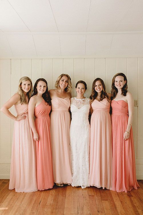 Bridesmaids in mismatched pink @jcrew dresses, accessorized with their own jewelry | Brides.com