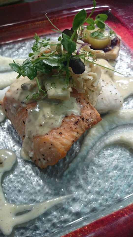 Salmon and hake, lemon fennel,  cauliflower puree, red onion tart, citrus cream sauce.