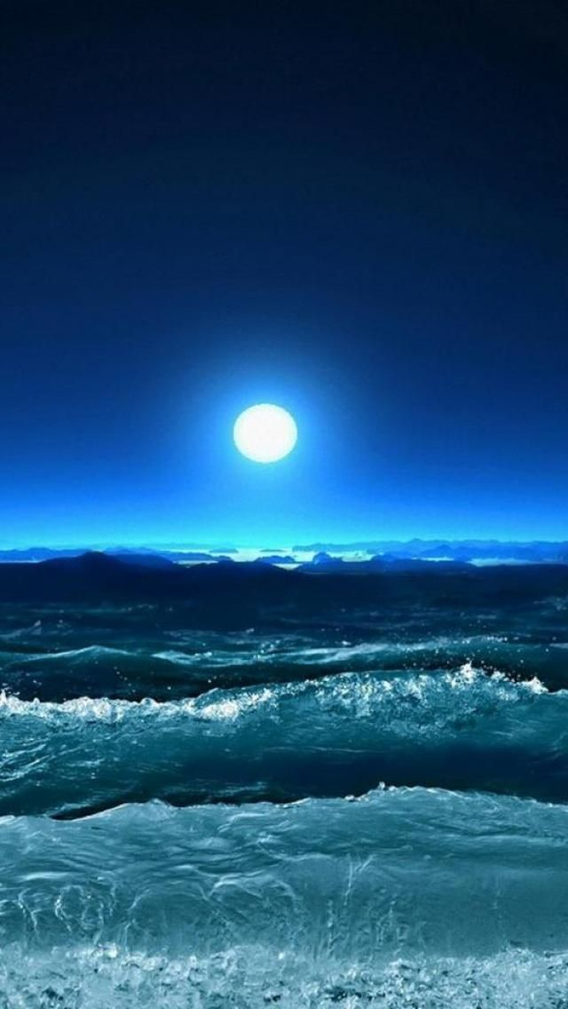 bright moon and blue ocean waves