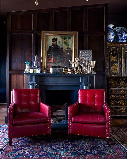WOOD PANELED WALLS, CHINOISERIE ARMOIR, MANTEL, ACCESSORIES... I DON'T LIKE THE RED LEATHER CHAIRS ..lol I like the chairs! Also like the dark walls with a dark mantle.