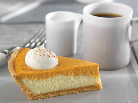Double Layer Pumpkin Cheesecake | A great alternative to pumpkin pie, especially for those cheesecake fans out there. Serve topped with whipped cream.