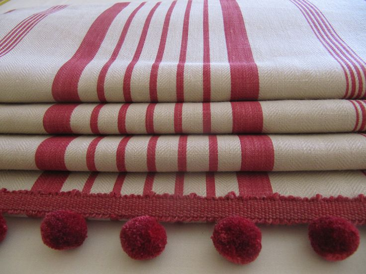 """Interlined roman blind for a kitchen, in Kate Forman """"Red Ticking"""" with a pom pom trim - hand made by Victoria Clark Interiors"""