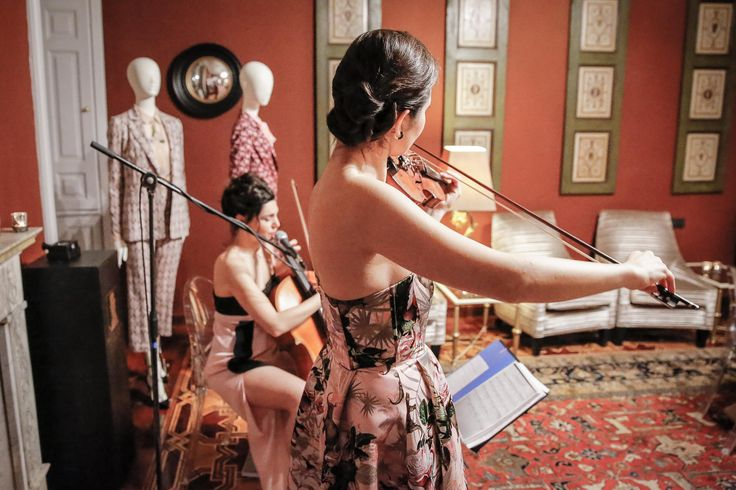 Cellist Eleuteria Arena and violinist Laura Masotto during PINKO Spring Summer 2016 collection presentation at The Gentleman of Verona Grand Relais
