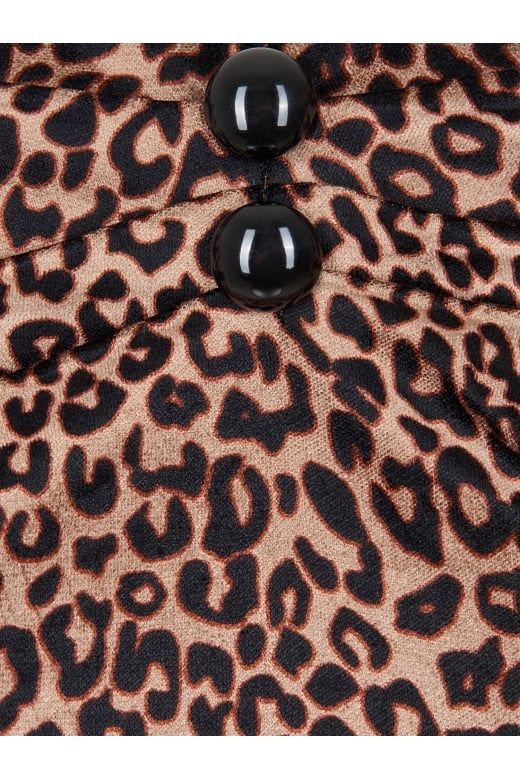 The classic Dolores Gypsy Top is now in a new Leopard print velvet fabric.  The Dolores is a classic 1950s style gypsy top with sweetheart neckline,  pleated bust detail with buttons, and elasticated sleeves that can be worn  on or off the shoulder. Pair with our Joanie Pencil skirt for a classic  rockabilly look.  Fabric:55% Viscose 43% Cotton 2% Spandex Washing Advice: Machine washable at 30 degrees.