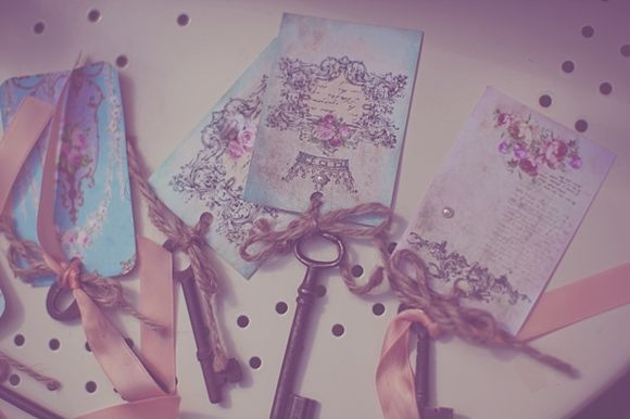 I love these old keys and pretty papers for table seating cards!