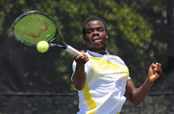 """An Improbable Tennis Prodigy: Francis Tiafoe grew up at College Park's Junior Tennis Champions Center, where his immigrant dad was the maintenance man. Now the 16-year-old is the country's best junior boy.  Francis Tiafoe, 16, has a full complement of shots and shows tactical savvy beyond his years. """"I'm like 35 in tennis years,"""" he says. """"I've been on a tennis court all my life."""" (Jahi Chikwendiu/The Washington Post)"""