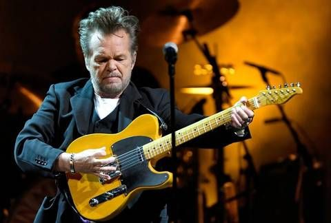 John Mellencamp brings his Sad Clowns and Hillbillies Tour to Cary, N.C.'s Booth Amphitheatre Wednesday night, June 28, 2017 with Emmylou Harris and Carlene Carter.
