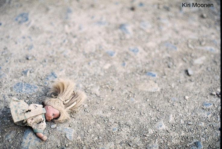 A doll on the road.  Film Photo by Kiri Moonen