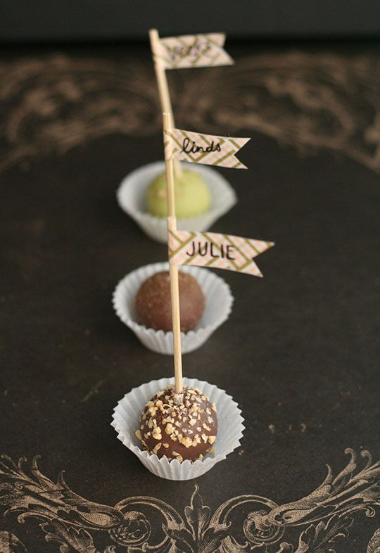 Edible place cards: place a toothpick pennant with each guest's name into a truffle