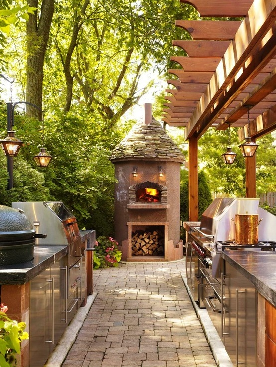 Outdoor kitchen with pizza oven and green egg, like the pendant lights too