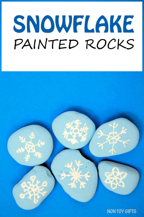 Snowflake painted stones for kids to play with. Winter craft. | at Non Toy Gifts