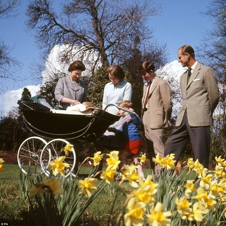 Pictured from left, Queen Elizabeth II, baby Prince Edward, Princess Anne, Prince Andrew, Prince Charles and the Duke of Edinburgh, in the gardens of Frogmore House, Windsor, Berkshire, as they celebrate the Queen's 39th birthday on April 21, 1965. The same pram was used to ferry the Queen's great-granddaughter Princess Charlotte to her christening in July this year. The Daily Mail.