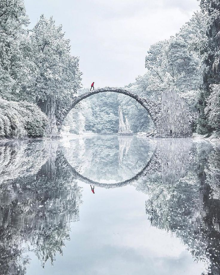 Nestled among the verdant foliage in Kromlau, Germany's Kromlauer Park, is a delicately arched devil's bridge known as the Rakotzbrücke, which was specifically built to create a circle when it is reflected in the waters beneath it.