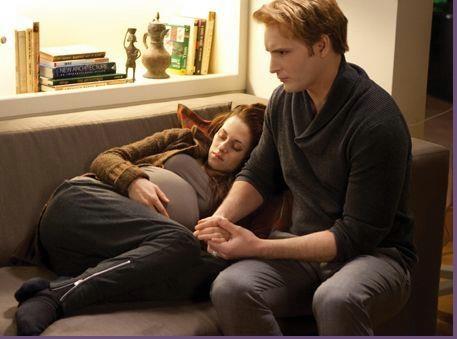 Carlisle (Peter Facinelli) checks on pregnant Bella (Kristen Stewart) in The Twilight Saga: Breaking Dawn Part 1.