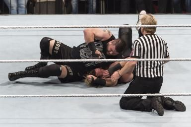 Fastlane 2016 Results and Recap: Kevin Owens punches Dolph Ziggler during a match in 2016.
