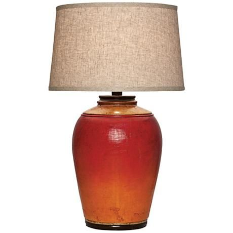 a bright and vibrant light red table lamp with orange detail near the base topped with - Red Lamp