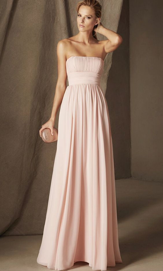 Stunning strapless empire waist pink bridesmaid dress; Featured Dress: Pronovias