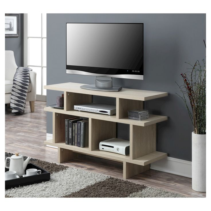 "The modern design of the TV Stand from Convenience Concepts showcases your TV and accessories in style. The milk white wood finished frame creates a beautiful focal point for your flat screen TV. The stand fits up to a 46"" television and the 5 open shelves underneath easily hold your cable box, DVD player and game console. The back of each shelf has a hole to cleverly hide your cables and cords behind the console table so they won't create a mess. Plus, the shelves will neatly hold y..."