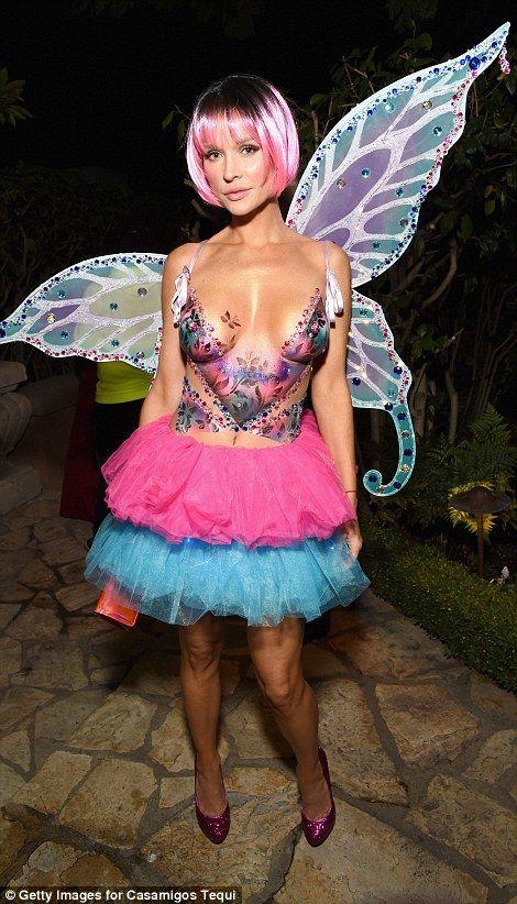 Model Joanna Krupa dared to bare in some body art for her fairy costume,...