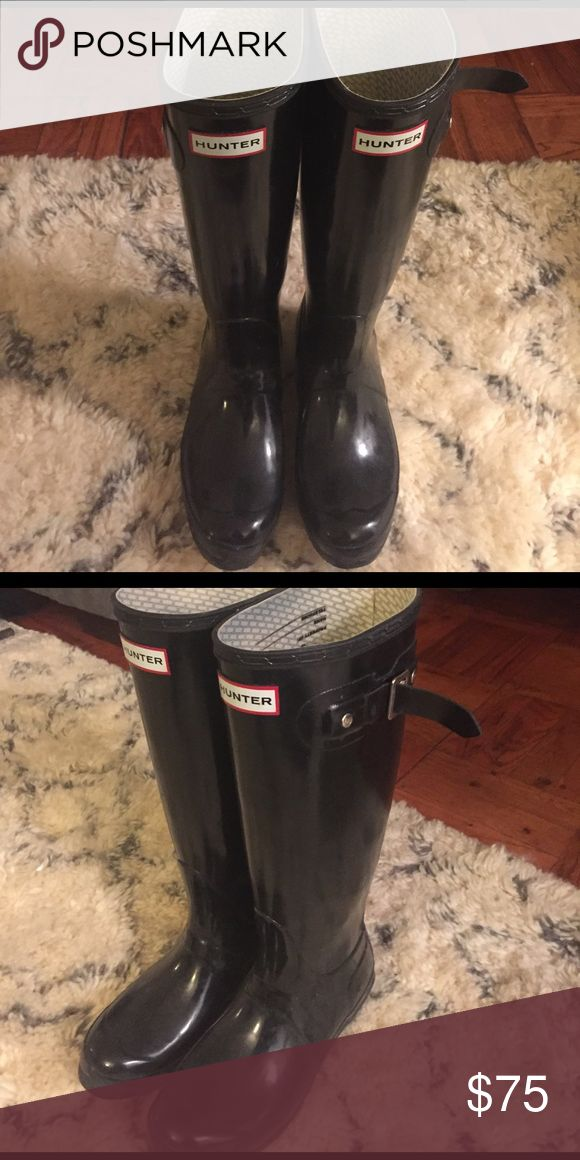 Hunter Original Tall Gloss Wellington Boots These black boots are a rainy day staple! Just because it's raining doesn't mean you can't be trendy! Hunter Boots Shoes Winter & Rain Boots