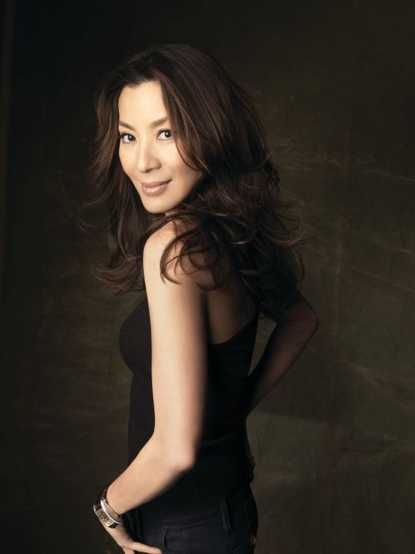 Michelle Yeoh - former beauty queen, ballerina, talented actress (does her own stunts and owns her own production company)