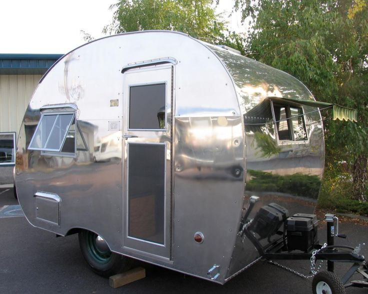 Great American Country has before and after photos of a refurbished 1947 silver Robin Hood travel trailer.