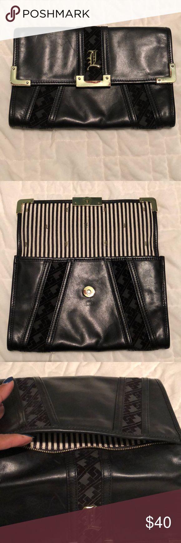 L.A.M.B. Gwen Stefani Black Leather Clutch L.A.M.B. Gwen Stefani Black Leather Clutch with black velour pattern. Perfect Friday night clutch! LAMB Bags Clutches & Wristlets