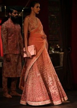 Model showcasing orange anarkali lehnga for sabyasachi at Indian couture week july 2014