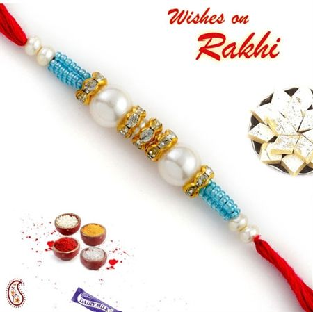 Picture of Pearl Rakhi with American diamonds and Turquoise Beads