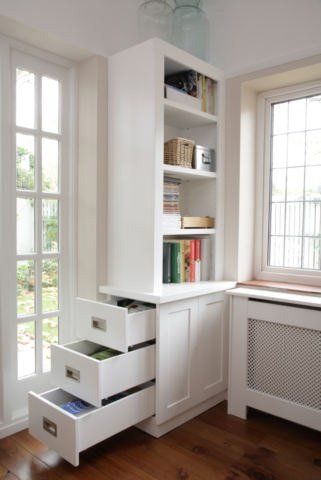 Rooms with Beautiful Built-Ins — Inspiration Gallery | Apartment Therapy These drawers work storage around obstacle (cabinet under window).