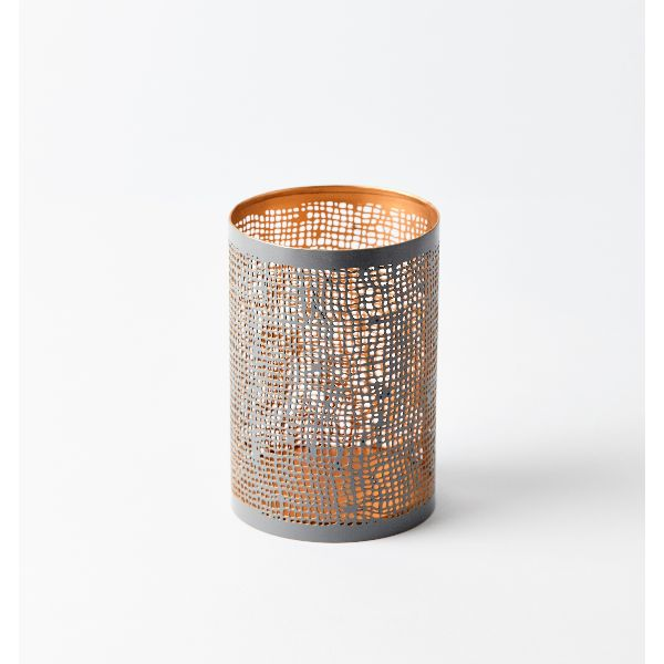 Medium Grey Lantern : This contemporary matt grey lantern with a perforated hessian style pattern can be used indoors or out. The grey lantern has a contrasting and complementary gold inner which adds to its decorative appeal. Create a welcoming atmosphere by placing several together in both the large and medium size on a mantle-piece or shelf and lighting with tea lights. The candle light will shine through the open fretwork which makes these lanterns an eye-catching feature. The soft…